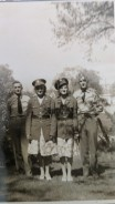 Visit home in Lyndon Station, WI. Left to right - Art, sister Ida, sister Eva and brother Arnie Rettammel